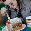 TIM JEAN/Staff photo<br /> <br /> Abby Conway, 15, adds frosting to the roof as she decorates a Gingerbread house at the Manchester Community Center.  12/5/18