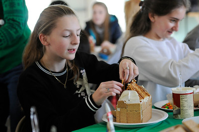 TIM JEAN/Staff photo  Allison Reeve, 13, left, and Kaitlyn Zachareas, 14, decorate Gingerbread houses at the Manchester Community Center.  12/5/18