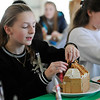 TIM JEAN/Staff photo<br /> <br /> Allison Reeve, 13, left, and Kaitlyn Zachareas, 14, decorate Gingerbread houses at the Manchester Community Center.  12/5/18