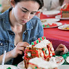 TIM JEAN/Staff photo<br /> <br /> Sophia Pomeroy, 17, puts the finishing touch as she decorates a Gingerbread house at the Manchester Community Center.  12/5/18