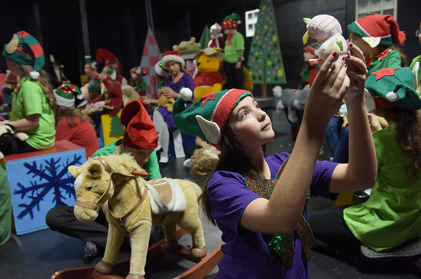TIM JEAN/Staff photo<br /> <br /> Alexis Thomas as Elf Sprinkles, checks a toy being made  during a dress rehearsal for Gloucester Stage Company's production of Holiday Delights. 12/4/18