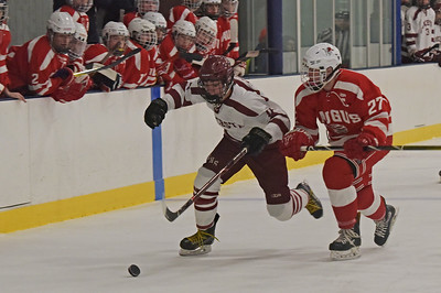 TIM JEAN/Staff photo  Gloucester's Colby Mitchell outskates Saugus's Charles Graffeo to the puck and looks to score during a boys hockey game at the Dorothy Talbot Ice Rink. Mitchell would score later in the game. 12/12/18