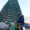 TIM JEAN/Staff photo<br /> <br /> Paul Wagner, right, opens the reels of new LED colorful lights as Dave Brooks, top, secures the lobster traps on top of the Lobster Trap Christmas tree in downtown Gloucester. The tree will be light on Saturday, with new LED colorful lights.     12/4/18