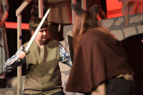 TIM JEAN/Staff photo  Nathaniel Clark as Peter, fights off the wood nymphs on stage during a rehearsal of Rockport Middle School's performance of C.S. Lewis' The Lion, the Witch and the Wardrobe.  12/11/18
