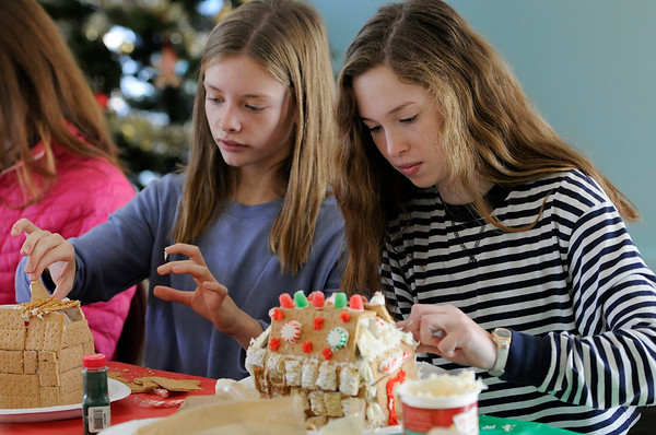 TIM JEAN/Staff photo  Katie Prinn, left, and Sophie Zalosh, both 13, decorate Gingerbread houses at the Manchester Community Center.  12/5/18