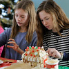 TIM JEAN/Staff photo<br /> <br /> Katie Prinn, left, and Sophie Zalosh, both 13, decorate Gingerbread houses at the Manchester Community Center.  12/5/18