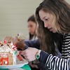 TIM JEAN/Staff photo<br /> <br /> Sophie Zalosh, 13, carfully decorates a Gingerbread houses at the Manchester Community Center.  12/5/18