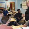 TIM JEAN/Staff photo<br /> <br /> Peter Ferrante, 72, right, a longtime Gloucester fishrman, answers questions from students after showing a slideshow about making a living on a fishing ship to Kerry Herrmann's history class at Rockport High School.   12/11/18