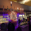 TIM JEAN/Staff photo<br /> <br /> Purple lights glow after a short prayer from Rabbi Stephen Lewis as he lights the Lobsta Trap Menorah outside the Temple Ahavat Achim Tuesday night.     12/4/18