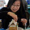 TIM JEAN/Staff photo<br /> <br /> Faye Dingle, 15, decorates a Gingerbread house at the Manchester Community Center.  12/5/18
