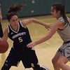 TIM JEAN/Staff photo<br /> <br /> Swampscott's Sophia DiGrande, left, drives past Manchester Essex's Grace Brennan during a girls basketball game at Manchester Essex High School.   12/11/18