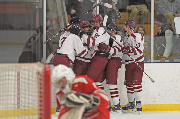 TIM JEAN/Staff photo  Gloucester's Colby Mitchell, center, celebrates scoring a goal with his teammates from left, Edward Field, Ryan Muniz, Ryan Bergin, and Timothy White against Saugus goaltender John Devereaux during a boys hockey game at the Dorothy Talbot Ice Rink. 12/12/18