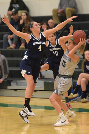 TIM JEAN/Staff photo<br /> <br /> Swampscott's Grace DiGrande (4) and Mackenzie Kearney (10) double team Manchester Essex's Suzanne Morton (15) during a girls basketball game at Manchester Essex High School.   12/11/18