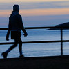 TIM JEAN/Staff photo<br /> <br /> A women is silhouetted by the setting sun as she walks along Western Avenue in Gloucester.   12/12/18