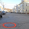 TIM JEAN/Staff photo<br /> <br /> A sewer cover is outlined with orange paint on Warner St., in Gloucester. Work is expecteted to begin in the spring on a major sewer project on Trask, Shepherd, Warner, Millett and Sargent Streets. 12/12/18