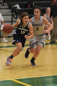TIM JEAN/Staff photo  Swampscott's Mackenzie Kearney, left, drives toward the hoop past Manchester Essex's Lily Athanas during a girls basketball game at Manchester Essex High School.   12/11/18