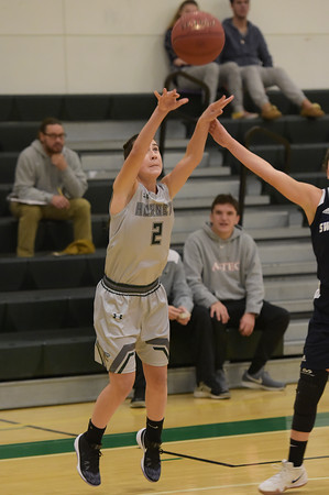 TIM JEAN/Staff photo<br /> <br /> Manchester's Lily Athanas shoots a 3 point shot against Swampscott during a girls basketball game at Manchester Essex High School.   12/11/18