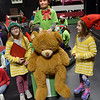 TIM JEAN/Staff photo<br /> <br /> Katie Jay, left, as Elf Snowball, checks the work being done by Onni Gibson, center, as Elf Christmas Tree, as Maddie Jay confems his good work, during a dress rehearsal for Gloucester Stage Company's production of Holiday Delights. 12/4/18