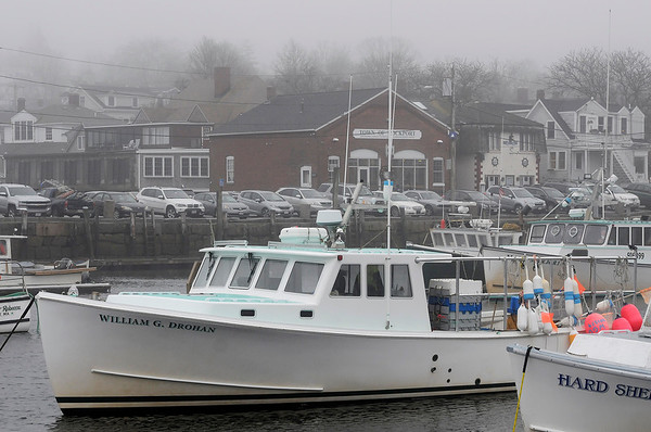 TIM JEAN/Staff photo<br /> <br /> The Lobster boat William G. Drohan sits in the Rockport harbor on a foggy day on Cape Ann.  12/21/18