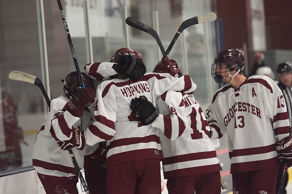 TIM JEAN/Staff photo  Gloucester's Derek Hopkins celebrates scoring a goal against Saugus with his teammates during a boys hockey game at the Dorothy Talbot Ice Rink.   12/12/18