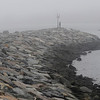 TIM JEAN/Staff photo<br /> <br /> People climb on the rocks out towards the point as the fog rolls in along Bearskin Neck in Rockport  12/21/18