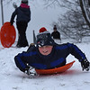 Sledding at Stage Fort Park