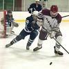 Desi Smith Staff photo/Gloucester Daily Times. Rockport's Dane Tolstrup chase the puck into the conner in the second period against Swampscott Saturday night at the Dorothy Talbot Rink.   February 1,2014.