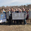 TIM JEAN/Staff photo<br /> <br /> Students in Rockport High School Science Club, Cape Ann Saving Bank's Bob Gillis, President, Marianne Smith, Senior V.P., Jen Orlando, Marking, Jamy Buchanan Madeja, Education Foundation of Rockport, Rob Liebow, Rockport Superintendent and several teachers of Rockport High School gathered for a check donation ceremony for  an Astronomy project to be built behing the middle School.      2/5/19