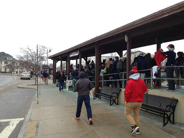 John Castelluccio/Staff photo<br /> A good crowd was gathering at the Railroad Avenue commuter rail station at 8 a.m. to take the train into Boston to watch the Patriots parade.