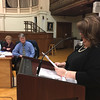 RAY LAMONT/Staff photo<br /> Mayor Sefatia Romeo Theken delivers her State of the City address Monday night in City Hall's Kyrouz Auditorium as City Councilors Val Gilman and Scott Memhard listen.