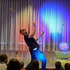 RYAN HUTTON/ Staff photo<br /> John Higby twirls two yo-yos at once during a performance with his wife Rebecca, who perform as the Yo-Yo People, at Rockport Public Library on Tuesday.