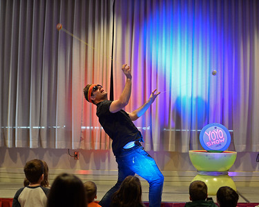 RYAN HUTTON/ Staff photo John Higby twirls two yo-yos at once during a performance with his wife Rebecca, who perform as the Yo-Yo People, at Rockport Public Library on Tuesday.