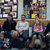 "SAM GORESH/Staff photo. Dads and their kids listen to local writer Jape Payette reads his ""Jape the Grape Ape from Outer Space"" book to kids during the Dads and Donuts program at the Sawyer Free Library. 2/18/17"