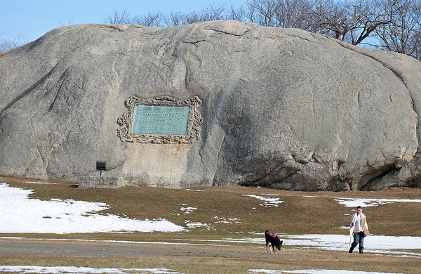 RYAN HUTTON/ Staff photo<br /> Jen Ronning walks her dog Jen in front of Tablet Rock at Stage Rock Park in Gloucester on Tuesday.