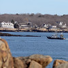 RYAN HUTTON/ Staff photo<br /> A trawler motors its way back into Gloucester harbor as seen from Stage Fort Park on Tuesday.