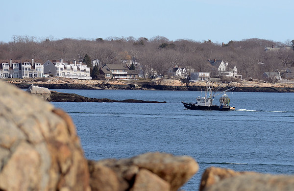 RYAN HUTTON/ Staff photo A trawler motors its way back into Gloucester harbor as seen from Stage Fort Park on Tuesday.