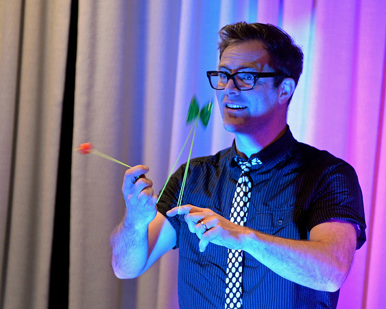 RYAN HUTTON/ Staff photo<br /> John Higby performs a dual yo-yo trick during the Yo-Yo People show at the Rockport Public Library on Tuesday.