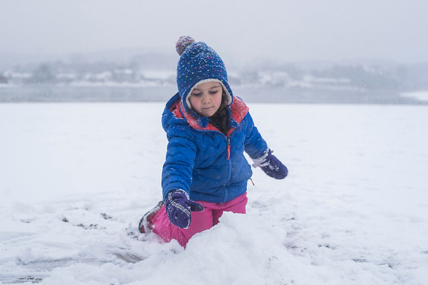 SAM GORESH/Staff photo. Molly Kantor, 3, of Newton builds a snow and sandcastle at Good Harbor Beach. 2/11/17