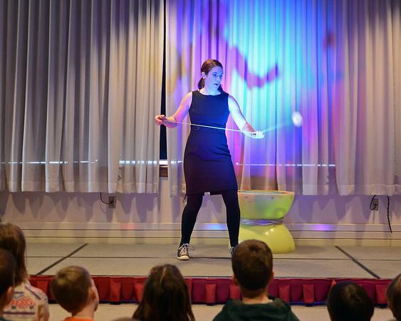 RYAN HUTTON/ Staff photo<br /> Rebecca Higby performs a yo-yo trick during the Yo-Yo People show at the Rockport Public Library on Tuesday.