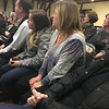 RAY LAMONT/Staff photo<br /> Karin ODonnell, foreground, whose mothers dog was killed by a coyote Jan. 15 on Rocky Neck, listens to state officials and residents discuss the issue.