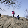 RYAN HUTTON/ Staff photo<br /> Valerie O'Nell climbs down Tablet Rock at Stage Fort Park in Gloucester with her son Corbin, 10 months, on her back and her son Liam, 5, leading the way on Tuesday.