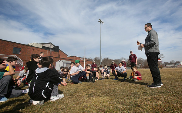 MIKE SPRINGER/Staff photo<br /> John Parisi, head coach of the Rockport High School Vikings baseball team, talks to children in the Vikings' February skills clinic on Wednesday. Over 30 kids, ages 7-12, are participating in the clinic.<br /> 2/21/2018