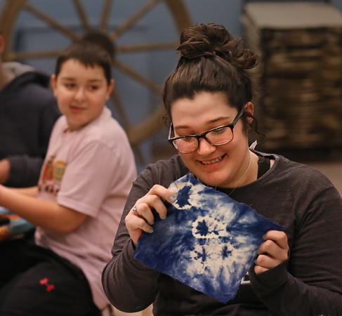 MIKE SPRINGER/Staff photo<br /> Seventeen-year-old Abby Feener examines a finished sample as 12-year-old Alex Kesterson, left, looks on during a shibori workshop Tuesday at the Cape Ann Museum in Gloucester. Feener, Kesterson and other members of the Cape Ann YMCA's Teen Leader club spent the afternoon with Kirsten Vega, education coordinator at the museum, learning shibori, an ancient Japanese method of dying cloth with indigo.<br /> 02/06/2018