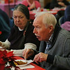 MIKE SPRINGER/Staff photo<br /> Lars Gren, right, and Jenn Leonowert enjoy the food and conversation during the annual Valentine's Day luncheon Thursday at the Rose Baker Senior Center in Gloucester.<br /> 2/15/2018