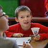 "MIKE SPRINGER/Staff photo<br /> Fifth-grader Anthony Merrill confers with classmates during a ""Chemist's Carnival"" Friday at Beeman Elementary School in Gloucester. Students in all three fifth grade classes took part in the event to celebrate the successful completion of a physical science unit on the structure and properties of matter. The children visited a series of stations to watch the making of a number of carnival treats, including popcorn, snow cones, cotton candy, hot dogs and lemonade. They were then tasked with determining whether the food preparation involved a chemical reaction or a simple non-chemical change in the state of the matter making up the food. They had to justify each opinion with a scientific explanation. Along the way, the children enjoyed a modest portion of each treat.<br /> 2/16/2018"