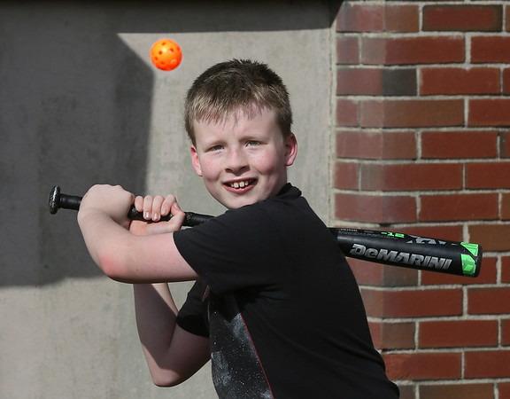 MIKE SPRINGER/Staff photo<br /> Ten-year-old Austin Story keeps his eyes on a Wiffle Ball during a batting exercise Wednesday in the Rockport High School Vikings baseball skills clinic. Over 30 children, ages 7-12, are participating in the clinic.<br /> 2/21/2018