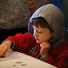 MIKE SPRINGER/Staff photo<br /> Five-year-old Christian Balili uses a rubber stamp to make a valentine card during a workshop for children Monday at the T.O.H.P. Burnham Public Library in Essex.<br /> 2/12/2018