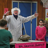 "MIKE SPRINGER/Staff photo<br /> Fourth graders from Elaine Engemann's class listen as ""Quinton Quark"" (physics teacher Ted Lawrence of Brattleboro, Vermont) gives instructions before a tug-of-war in which the students would try (unsuccessfully) to separate the two sides of a Magdeburg hemisphere -- a pair of copper shells with all the air pumped out, first used by Otto von Guericke in 1654 -- to demonstrate the power of atmospheric pressure during a ""Slapstick Science"" program Tuesday at Veterans Memorial Elementary School in Gloucester. Lawrence gave a program on the science of flight, which included a number of subjects, including gravity, friction and air pressure.<br /> 2/13/2018"