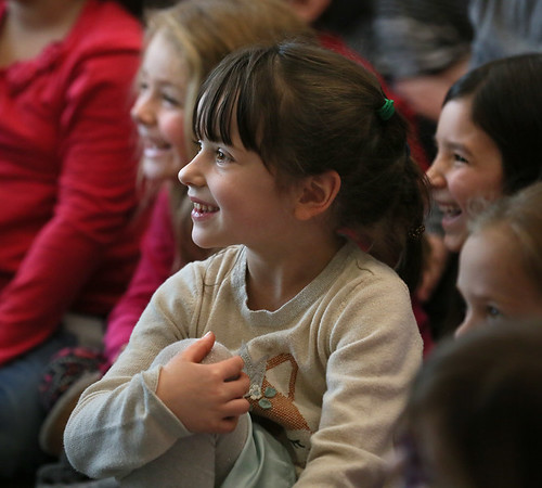 MIKE SPRINGER/Staff photo<br /> Kindergartner Iona Fishburne enjoys a reptile show Thursday at West Parish Elementary School.<br /> 02/01/2018