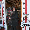 MIKE SPRINGER/Staff photo<br /> Pam Wasserman, owner of the Good Dog Gallery on Bearskin Neck in Rockport, looks out from the front door with her miniature poodle, Piper.<br /> 01/31/2018